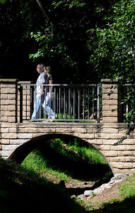 A couple walks over a bridge in Verdugo Park near the campus of Glendale Community College in Glendale, CA 6-28-2011. (John McCoy/Staff Photographer)