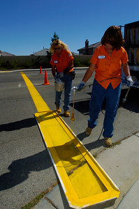 City of Palmdale public Work Maintenence workers left Joy Sutherland and Donna Funderburg paint a school cross walk on Thursday in preperation for schools openiong on monday.