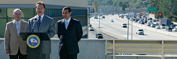 As all South-bound lanes of I-405 just past the 101 remained jammed at 10:27 a.m., (L-R) L.A. Chamber of Commerce Board Chair David Fleming, California Governor Arnold Schwarzenegger and Los Angeles Mayor Antonio Villaraigossa along with other local and state officials announced the completion of the $48,000,000 traffic project from the top of the Sherman Oaks Galleria on Friday, Oct. 19, 2007 over-looking the US-101 and I-405 freeway intersections which were re-designed to flow more traffic through what's known as the worst bottleneck in the country and one of the worse in the world. (John Lazar / L.A. Daily News Staff Photographer)