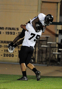 Servite's Malik Felton #23 is lifted up by Travis Averill #75 after Felton scored a first half touchdown against Crespi during  their Southern Section Pac-5 Division football quarterfinals Friday, November 26, 2010. (Hans Gutknecht/Staff Photographer)