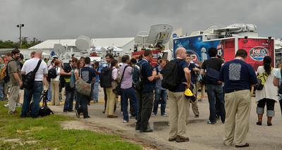 News media get drench in rain as they try to get photos with only 1 day left to cover the last space shuttle launch of Atlantis that is set for July 8th at Kennedy Space Center. FL. July 7,2011. Photo by Gene Blevins/LA Daily News