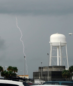 Storm clouds with lightning pass over KSC that could delay the launch with zero days left for last space shuttle launch of Atlantis that is set for July 8th at Kennedy Space Center. FL. July 7,2011. Photo by Gene Blevins/LA Daily News