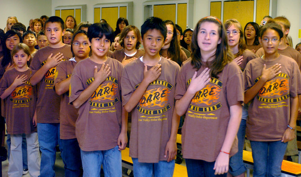At Athwerwood Elementary School in Simi Valley, Ca., 6h grade students and D.A.R.E. graduates say the Pledge of Allegiance on Friday, June1, 2007 before their graduation ceremony.  (Tina Burch/Staff Photographer)