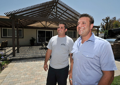"""(l-r) Anthony Cassella and Billy Derian stand in the renovated backyard.  Cassella's backyard got the """"Gentleman's Ranch""""-treatment from Billy Derian, host of DIY Network's Extra Yardage: a half-hour landscaping series in which neglected decks, patios and yards are transformed into world-class outdoor entertainment spaces. The yard will be featured in an upcoming episode of the series. Simi Valley Ca 7-29-2011. (John McCoy/Staff Photographer)"""