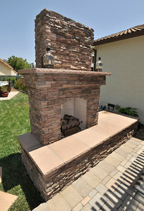 """New fireplace in Anthony Cassella's backyard that got the """"Gentleman's Ranch""""-treatment from Billy Derian, host of DIY Network's Extra Yardage: a half-hour landscaping series in which neglected decks, patios and yards are transformed into world-class outdoor entertainment spaces. The yard will be featured in an upcoming episode of the series. Simi Valley Ca 7-29-2011. (John McCoy/Staff Photographer)"""