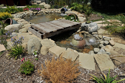 """This water feature is in Anthony Cassella's backyard got the """"Gentleman's Ranch""""-treatment from Billy Derian, host of DIY Network's Extra Yardage: a half-hour landscaping series in which neglected decks, patios and yards are transformed into world-class outdoor entertainment spaces. The yard will be featured in an upcoming episode of the series. Simi Valley Ca 7-29-2011. (John McCoy/Staff Photographer)"""