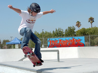 Jack Webb, 11 of Los Angeles, works on skateboarding tricks at Pedlow Skate Park in Encino, Ca., during a City of Los Angeles Park and Recreation Summer Camp on Friday, August 17, 2007.  (Tina Burch/Staff Photographer)