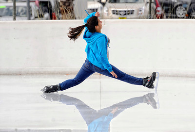 People enjoy themselves Monday, October 24, 2011 at Woodland Hills Ice at the corner of Topanga Canyon Boulevard and Erwin Street in Woodland Hills. The outdoor facility features over 7,000 square feet of real ice and is open 7 days a week through February 5, 2012. (Hans Gutknecht/Staff Photographer)