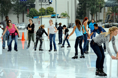 Children and parents from Circus Vargas  take a break from the circus to enjoy some skating Monday, October 24, 2011 at Woodland Hills Ice in Woodland Hills. The outdoor facility features over 7,000 square feet of real ice and is open 7 days a week through February 5, 2012. (Hans Gutknecht/Staff Photographer)