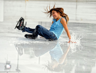 Mariella Quiroga, 13-years-old, takes a spill  while skating Monday, October 24, 2011 at Woodland Hills Ice at the corner of Topanga Canyon Boulevard and Erwin Street in Woodland Hills. The outdoor facility features over 7,000 square feet of real ice and is open 7 days a week through February 5, 2012. (Hans Gutknecht/Staff Photographer)