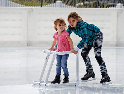Graciella Quiroga, 3-years-old, is pushed by sister Daniella Monday, October 24, 2011 at Woodland Hills Ice at the corner of Topanga Canyon Boulevard and Erwin Street in Woodland Hills. The outdoor facility features over 7,000 square feet of real ice and is open 7 days a week through February 5, 2012. (Hans Gutknecht/Staff Photographer)