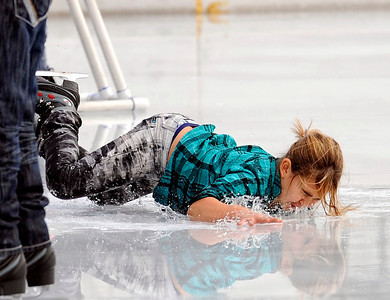 Daniella Quiroga, 8-years-old, takes a fall while skating Monday, October 24, 2011 at Woodland Hills Ice at the corner of Topanga Canyon Boulevard and Erwin Street in Woodland Hills. The outdoor facility features over 7,000 square feet of real ice and is open 7 days a week through February 5, 2012. (Hans Gutknecht/Staff Photographer)