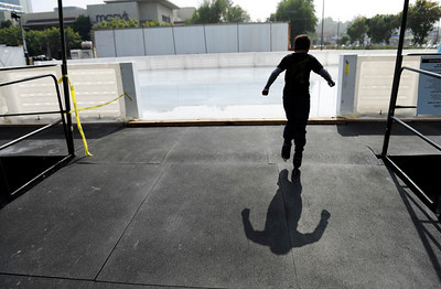 Antony Bachliyski. 9-years-old, makes his way on to the ice to skate Monday, October 24, 2011 at Woodland Hills Ice at the corner of Topanga Canyon Boulevard and Erwin Street in Woodland Hills. The outdoor facility features over 7,000 square feet of real ice and is open 7 days a week through February 5, 2012. (Hans Gutknecht/Staff Photographer)