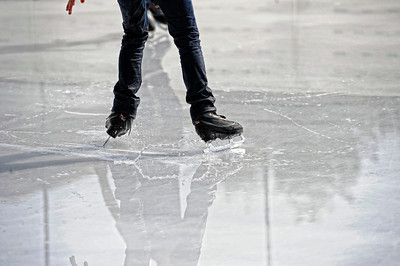 People enjoy themselves while skating Monday, October 24, 2011 at Woodland Hills Ice at the corner of Topanga Canyon Boulevard and Erwin Street in Woodland Hills. The outdoor facility features over 7,000 square feet of real ice and is open 7 days a week through February 5, 2012. (Hans Gutknecht/Staff Photographer)