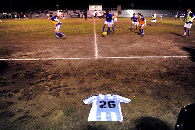 El Camino Real's Francisco Rodriguez's jersey lays on the ground near the team bench as El Camino Real warms up to play Cleveland at Cleveland High School in Reseda Friday, January 13, 2011. Rodriguez was murdered outside of his Winnetka home on Wednesday. (Hans Gutknecht/Staff Photographer)