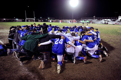 El Camino Real soccer huddle together before their game against Cleveland at Cleveland High in Reseda on Friday, January 13,2012. El Camino goalie Francisco Rodriguez  was murdered outside of his Winnetka home on Wednesday after a game.  (Hans Gutknecht/Staff Photographer)