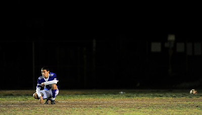 El Camino Real soccer player Osvaldo Martinez (2) takes a moment before their game against Cleveland, during a moment of silence for teammate Francisco Rodriguez who was murdered outside of his Winnetka home on Wednesday.  (Hans Gutknecht/Staff Photographer)