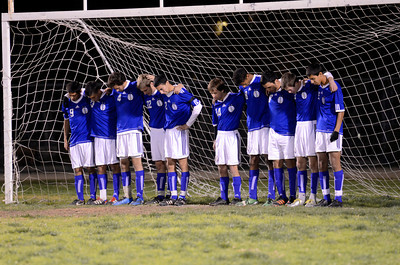 El Camino Real soccer players stand in the goal before their game against Cleveland, during a moment of silence for teammate Francisco Rodriguez who was murdered outside of his Winnetka home on Wednesday.  (Hans Gutknecht/Staff Photographer)