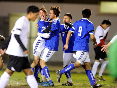 El Camino Real players mob Lucas Ladek (14) after his goal during their game against Cleveland' at Cleveland High School in Reseda Friday, January 13, 2011.  (Hans Gutknecht/Staff Photographer)