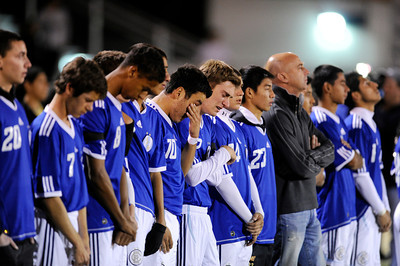 El Camino Real soccer players stand on the sideline as team captains meet mid-field before their game against Cleveland at Cleveland High in Reseda on Friday, January 13,2012. El Camino goalie Francisco Rodriguez  was murdered outside of his Winnetka home on Wednesday after a game.  (Hans Gutknecht/Staff Photographer)