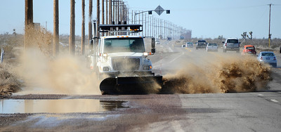 Cal Trans uses their snow plows to remove the melting snow that is causing large pools of mud and water to form on Pearblossom Hwy and highway 18 between Littlerock and Victorville as the snow is starting to melt. Littleriock, CA. Photo by Gene Blevins/LA Dailynews