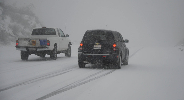 Drivers were in whiteout conditions along Templin Hwy that covered the Newhall pass to Santa Clarita and the Grapevine as residents were treated to an early 2011 snowfall Sunday afternoon after a light rain turned to flurries and then to a heavy snowfall. Castaic Lake CA. Jan 2,2011 Photo by Gene Blevins/LA DailyNews