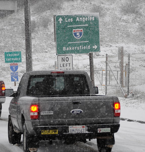 Drivers had a tough time driving on the south bound I 5 freeway that  was in heavy snow that covered the Newhall pass to Santa Clarita and the Grapevine as residents were treated to an early 2011 snowfall Sunday afternoon after a light rain turned to flurries and then to a heavy snowfall. Castaic Lake CA. Jan 2,2011 Photo by Gene Blevins/LA DailyNews