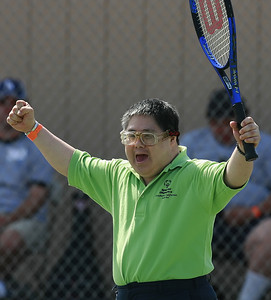 Teddy Yoshida of the South Bay tennis team clinches his fists after winning his sets against his opponent from the Greater Los Angeles team during one of many tennis games on the courts at Hart High School where nearly 800 Special Olympics athletes from all  over Southern California ages 8-80 with Down's Syndrome, autism  and mild retardation competed in basketball, bocce, swimming, track and field, and tennis in Newhall, CA, on Saturday, May 19, 2007.  ( John Lazar/L.A. Daily News Staff Photographer )