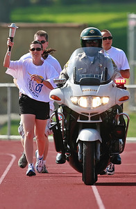 Motorcycle officers from the Santa Clarita Sheriff's Dept. and the Newhall CHP lead the way with lights and sirens in front of CHP officer Denise Joslin who carried the Special Olympic torch half the distance and starting the games on Hart High's track where nearly 800 Special Olympics athletes from all  over Southern California ages 8-80 with Down's Syndrome, autism  and mild retardation competed in basketball, bocce, swimming, track and field, and tennis in Newhall, CA, on Saturday, May 19, 2007.  ( John Lazar/L.A. Daily News Staff Photographer )