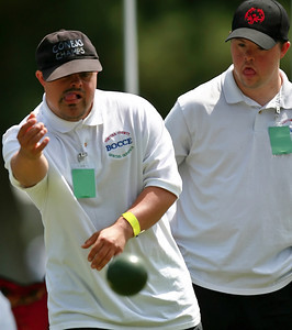 Joe Montemora, left, of the Ventura County Bocce team throws his ball as a teammate watches from behind during the Bocce competition against the Greater Los Angeles team on the Hart Park field where nearly 800 Special Olympics athletes from all  over Southern California ages 8-80 with Down's Syndrome, autism  and mild retardation competed in basketball, bocce, swimming, track and field, and tennis in Newhall, CA, on Saturday, May 19, 2007.  ( John Lazar/L.A. Daily News Staff Photographer )