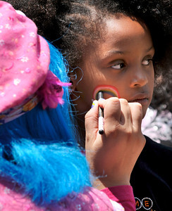 """Londyn Harris ,7, of North Hollywood has a rainbow painted on her cheek. Churches, ministries and community groups attended an event titled """"Uplifting of the American Spirit"""" to celebrate Independence Day at Hansen Dam Park. Churches held old-fashioned picnics with their congregations while listening to inspirational music played on outdoor stages. Vendors offered food, prizes, and other activities to members of the community. Lakeview Terrace, CA 07/03/2010 (John McCoy/Staff Photographer)"""