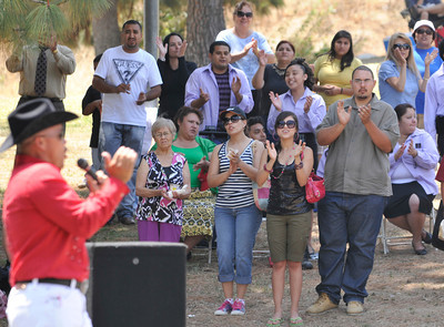 """Pedro Rivera, the Singing Pastor from Iglesia Primer Amor church, sings a style of Ranchero/Gospel music to the crowd. Churches, ministries and community groups attended an event titled """"Uplifting of the American Spirit"""" to celebrate Independence Day at Hansen Dam Park. Churches held old-fashioned picnics with their congregations while listening to inspirational music played on outdoor stages. Vendors offered food, prizes, and other activities to members of the community. Lakeview Terrace, CA 07/03/2010 (John McCoy/Staff Photographer)"""