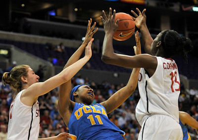 Stanford #31 Toni Kokenis and #13 Chiney Ogwumike pull a rebound away from UCLA #11 Atonye Nyingifa. Stanford defeated UCLA in the Womens PAC 10 Conference Championship 64-55 at Staples Center in Los Angeles, CA. 3-11-2011. (John McCoy/staff photographer)