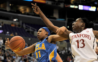 Bruins #11 Atonye Nyingifa and Stanford #13 Chiney Ogwumike get tangled up when Nyingifa was driving toward the hoop in the first half of play. Stanford defeated UCLA in the Womens PAC 10 Conference Championship 64-55 at Staples Center in Los Angeles, CA. 3-11-2011. (John McCoy/staff photographer)