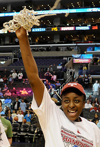 Stanford MVP Nnemkadi Ogwumike waves the net around after cuting it from the hoop. Stanford defeated UCLA in the Womens PAC 10 Conference Championship 64-55 at Staples Center in Los Angeles, CA. 3-11-2011. (John McCoy/staff photographer)