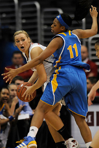 Stanford #44 Joslyn Tinkle is closely guarded by UCLA #11 Atonye Nyingifa. Stanford defeated UCLA in the Womens PAC 10 Conference Championship 64-55 at Staples Center in Los Angeles, CA. 3-11-2011. (John McCoy/staff photographer)