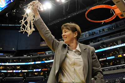 Stanford coach Tara VanDerveer cuts down the net after they defeated UCLA in the Womens PAC 10 Conference Championship 64-55 at Staples Center in Los Angeles, CA. 3-11-2011. (John McCoy/staff photographer)