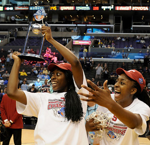 (l-r) Chiney Ogwumike and Nnemkade Ogwumike leave the floor with the throphy and net after the game. Stanford defeated UCLA in the Womens PAC 10 Conference Championship 64-55 at Staples Center in Los Angeles, CA. 3-11-2011. (John McCoy/staff photographer)
