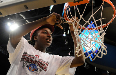 Stanford MVP Nnemkadi Ogwumike cuts the net after the victory. Stanford defeated UCLA in the Womens PAC 10 Conference Championship 64-55 at Staples Center in Los Angeles, CA. 3-11-2011. (John McCoy/staff photographer)