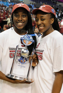(l-r) Chiney Ogwumike and Nnemkade Ogwumike with the throphy and net after the game. Stanford defeated UCLA in the Womens PAC 10 Conference Championship 64-55 at Staples Center in Los Angeles, CA. 3-11-2011. (John McCoy/staff photographer)