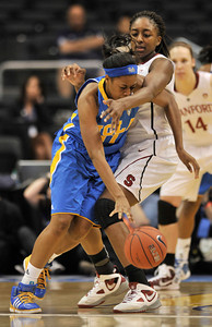 Bruins #11 Atonye Nyingifa tries to get around Stanford #30 Nnemkadi Ogwumike. Stanford defeated UCLA in the Womens PAC 10 Conference Championship 64-55 at Staples Center in Los Angeles, CA. 3-11-2011. (John McCoy/staff photographer)