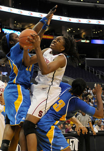 Stanford #30 splits UCLA defenders #23 Markel Walker and #33 Jasmin Dixon in the 2nd half. Stanford defeated UCLA in the Womens PAC 10 Conference Championship 64-55 at Staples Center in Los Angeles, CA. 3-11-2011. (John McCoy/staff photographer)