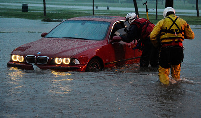LA city fire swift water rescue teams help drivers from their cars that got flooded along Balboa Blvd during the heavy rain storm that came through the valley that caused major flooding and blown down trees. Van Nuys. March 20,2011. Photo by Gene Blevins/LA Daily News
