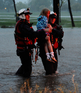 LA city fire swift water rescue teams help bring out a little girl from a car that got flooded along Balboa Blvd during the heavy rain storm that came through the valley that caused major flooding and blown down trees. Van Nuys. March 20,2011. Photo by Gene Blevins/LA Daily News