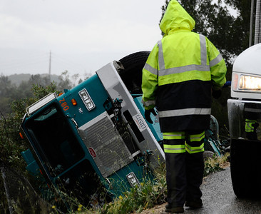 A trash truck flip over off the side of the road as the pavement gave way from underneath it from the heavy rain storms last night that came through the valley in Sunland CA. March 21,2011. Photo by Gene Blevins/LA Daily New