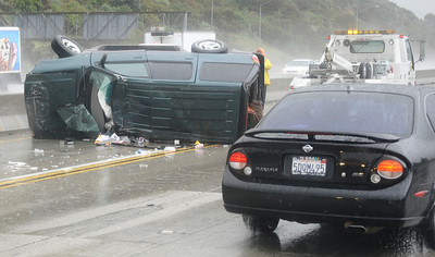 A overturn SUV on the east bound 134 freeway pass the 2 freeway, just one of many crashes that happen today from the heavy rain storms  that came through the valley today. Glendale March 21,2011. Photo by Gene Blevins/LA Daily New