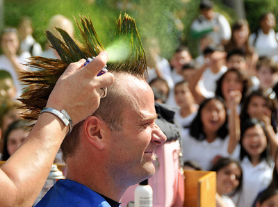 Students at Madison Middle School in North Hollywood were challenged by their Assistant Principal, Bill Hedrick, and Dean, Justin Lauer, and Security Officer Manny Villanueva, to improve thier API Scores above the 690 mark. They promised to shave their heads into mohawks during a school assembly if they were successful. The students improved from 671 to 704, smashing the old score by 33 points. Hair Dresser Eileen Solomon brought her clippers, and gave the haircuts during an assembly in front of the entire school. North Hollywood , CA 9/31/2010 (John McCoy/staff photographer)