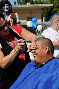 Manny Villanueva smiles as Eileen Solomon paints his mohawk. Students at Madison Middle School in North Hollywood were challenged by their Assistant Principal, Bill Hedrick, and Dean, Justin Lauer, and Security Officer Manny Villanueva, to improve thier API Scores above the 690 mark. They promised to shave their heads into mohawks during a school assembly if they were successful. The students improved from 671 to 704, smashing the old score by 33 points. Hair Dresser Eileen Solomon brought her clippers, and gave the haircuts during an assembly in front of the entire school. North Hollywood , CA 9/31/2010 (John McCoy/staff photographer)