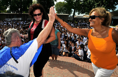Bill Hedrick gets a high five from Principal Estelle Baptiste after Eileen Solomon gave him a haircut. Students at Madison Middle School in North Hollywood were challenged by their Assistant Principal, Bill Hedrick, and Dean, Justin Lauer, and Security Officer Manny Villanueva, to improve thier API Scores above the 690 mark. They promised to shave their heads into mohawks during a school assembly if they were successful. The students improved from 671 to 704, smashing the old score by 33 points. Hair Dresser Eileen Solomon brought her clippers, and gave the haircuts during an assembly in front of the entire school. North Hollywood , CA 9/31/2010 (John McCoy/staff photographer)