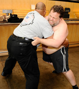 (R) Team USA world game champion sumo wrestler Kelly Gneiting shows some of his sumo moves with sumo wrestler Americus Abesamis for  the media as he will try to for a Guinness book world records for the heaviest man to race in the Los Angeles marathon. Kelly weighed in at 400.8 pounds during a press conference at Dodger Stadium and will be weighed in at the start and finish of the LA marathon. Los Angeles CA.   March 19,2011. Photo by Gene Blevins/LA Daily New